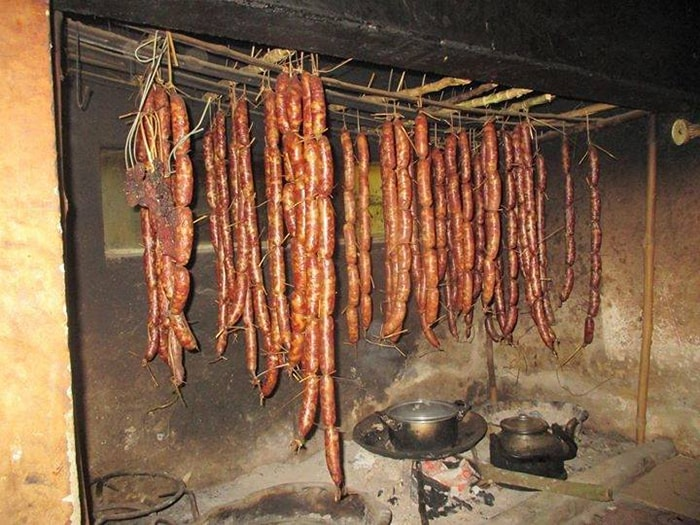 Smoked sausage hung in kitchen of a H'mong family